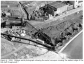 Figure 6.  1950.  Oblique aerial photograph showing the aerial conveyor crossing the eastern edge of the Site (left foreground)